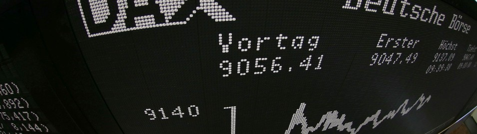 A trader uses a phone on the trading floor of Frankfurt stock exchange